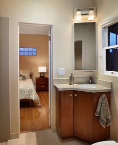 Bathroom: Diy Corner Bathroom Sink And Vanity Cabinet That Have White Double Doors Used Steel Legs Around The Concrete Wall from Pros and Cons of Corner Bathroom Sink