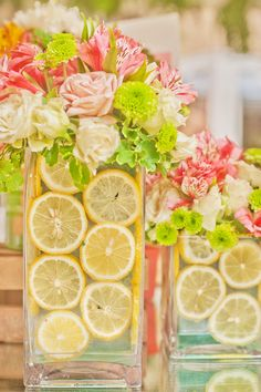 Gorgeous floral centerpiece with spring blooms  fresh lemon slices