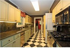 wonderful art deco black and white tile in kitchen