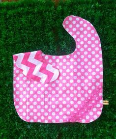 Oversized No Mess Reversible Bib in Quaint Ta Dots / Chevron Bubblegum Pink. Wear it on your tot during feeding time. The oversized bib protects your child's clothing... No need to worry about spills, stains and mess! Best especially for moms who are scared of getting their child's clothes dirty! =)  Send us a message at info@ilovebabinski.com & LIKE us on Facebook  Php 120.00 www.ilovebabinski.com