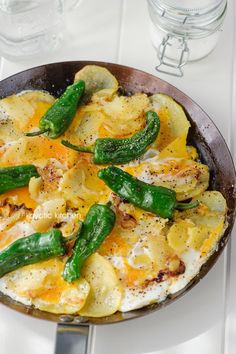 1- Spanish Padrón Pepper Huevos Estrellados _ Eating them alongside sweet caramelized onions, crunchy olive-oil potatoes, garlic & soft eggs makes these peppers soar to heights one would never expect a humble pepper to reach. For brunch or lunch!