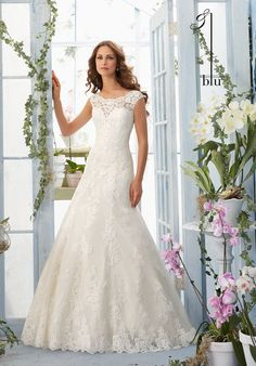 Embroidered Appliqués with Crystal Beading Accent the Soft Tulle Gown with Satin Waistband