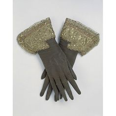 Beading these cuffs would be eminently suitable as a long winter handiwork project. Pair of embroidered leather gloves with silver and silver-gilt thread. Applied cuffs embroidered with metal threads, spangles, strip and purl. With underlay of coral-coloured silk ribbon. C. 1660s. © Victoria and Albert Museum, London