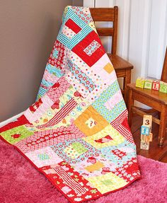 """This colorful baby quilt pattern calls for pre-cut 2-1/2"""" strips in bright prints for baby. If you're looking for an easy quilt to make for a shower gift or new baby, this is it!"""
