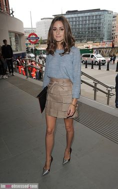 Shop this look for $213:  http://lookastic.com/women/looks/silver-heels-and-tan-mini-skirt-and-light-blue-longsleeve-shirt-and-black-clutch/2096  — Silver Suede Pumps  — Tan Leather Mini Skirt  — Light Blue Longsleeve Shirt  — Black Leather Clutch