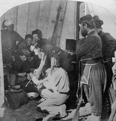 Army doctors performing an amputation in a make-shift hospital during the U.S. Civil War