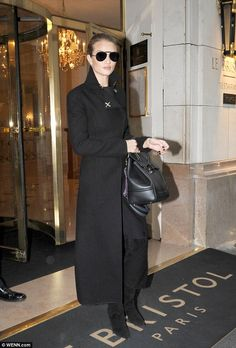 Tres chic! Rosie Huntington-Whiteley kept it monochrome once again when she made a glamorous exit from Paris' Le Bristol Paris hotel ahead of her debut at the French capital's Fashion Week for menswear - January 23, 2016
