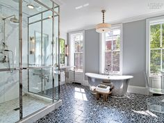 7 Breathtaking Bathrooms | The master bathroom of a New York town house by Markzeff. #design #interiordesign #interiordesignmagazine #projects #bathrooms