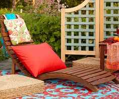 Lay a Colorful Floor Covering Create a relaxing escape where friends love to gather with florid fabrics and spicy hues. This outdoor room takes on an exotic feel with a stylish floor covering that breaks up the deck's large expanses of wood. Outdoor Carpet, Indoor Outdoor Rugs, Outdoor Rooms, Outdoor Chairs, Outdoor Living, Outdoor Decor, Deck Decorating, Decorating Your Home, Pool Chairs