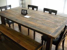 Reclaimed barn wood - rugged style with what looks like Napoleon chairs. Nice pairing.
