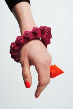 Theresa Burger   Triangular bangle and hexagonal ring - An Irish jewellery designer that has taken to 3D printing to add to her collection.  Check out her gallery at http://theresaburger.com/gallery/