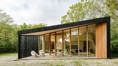 Dutch office Orange Architects has completed a compact holiday home on the island of Texel in the Netherlands, featuring an interior that adapts to its occupants' changing needs throughout the day. Prefab Buildings, Timber Cabin, Timber House, Timber Structure, Roof Light, Modern Exterior, Black Exterior, Architect Design, Large Windows