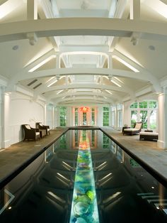 Indoor #pool with a built-in #aquarium running down the center. A truly innovative + unique #design.