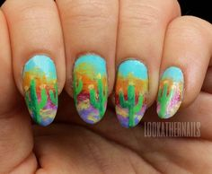 lookathernails:  Next week is spring break and that means I'm heading back to the Arizona desert and those amazing desert sunsets! I used a dry brush technique to create these sunset nails to make it look a bit like the clouds.
