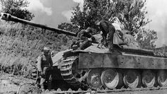Russian soldiers with a captured Panther Ausf D likely after fighting for Kursk in 1943