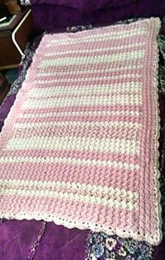 Pattern uses two strands of worsted weight yarn held together.