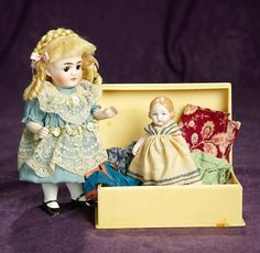 """7"""" German all-bisque miniature doll by Kestner, with little Hertwig doll and costumes. $400/500"""