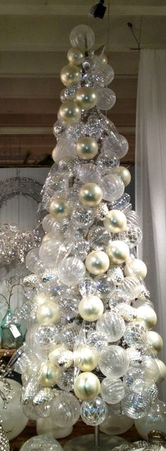 Pearl glass ornaments over chicken wire covered tomato cage . Duck tape the…
