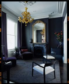 This room continues to look huge even with black walls. Love the gold pops with the chandelier and mirror.