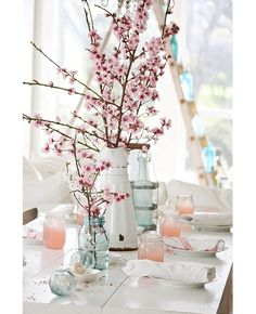 Such a pretty table. Look at the ladder in the background with the blue jars. Lovely!