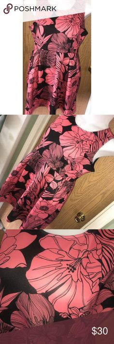 """Coral floral scuba knit skater dress Gorgeous coral and black floral scuba knit fit & flare dress.  ❗️Please no low ball offers.❗️ ❗️Bundles always get a discount.❗️ Please check measurements before purchasing.  Condition: NWT Measurements- Armpit to armpit: 22"""" Total length: 36"""" Flat across the waist: 18"""" Smoke free home but I have a small dog.  Thanks for checking out my closet! ❤️ Apt. 9 Dresses"""