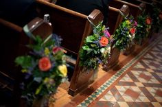 Beautiful flowers on pews
