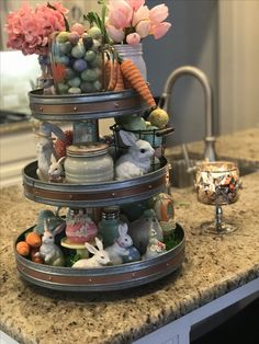 Add Easter themed decor items to a tiered tray for a great Spring decoration. Easter Table Decorations, Table Centerpieces, Easter Centerpiece, Galvanized Tiered Tray, Galvanized Decor, Spring Decoration, Decoration Crafts, Tiered Stand, Tiered Server