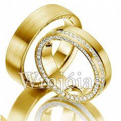 Alianças em ouro amarelo 18 kilates 750 modelo anatômico com 7 milímetros, acabamento liso. Modelo exclusivo com preço especial