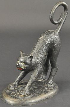 SPRINGING CAT WITH NINE TAIL DOORSTOP : Lot 432