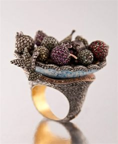 Hummingbird and a fruit plate ring by Sevan Biçakçi.  This ring looks as though it could be part of the realm.