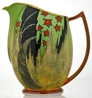 Art Deco Rare Carlton Ware Jug in the Spangled Tree Design, No 4163, sponged yellow ground gloss, orange handle and rim base. In production 1937 - 1942.