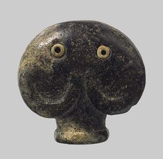 Elephant, Late Naqada II (ca. 3650–3300 b.c.) Egyptian Serpentine, bone Few amulets from the Predynastic Period are known. In the past, Egyptologists identified these amulets as representing a bull's head, but the round face and eyes, the horns that curve inward to the face, and a snout with a defined ridge make a strong argument for its identification as an elephant.