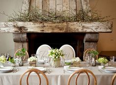 Beautiful dinner setting. Love the decor on the mantel too. Image from Sugar & Charm, by Shannon and photo credit: Larissa Cleveland of http://www.larissacleveland.com/