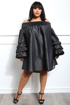6621ea305660 Add a little drama to your look with this plus size ruffle-sleeve dress