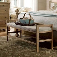 """Distressed wood bench.Product: BenchConstruction Material: Poplar veneers, hardwood solids and fabricColor: Oatmeal Dimensions: 24"""" H x 56"""" W"""