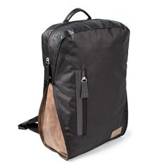 upcycled backpack in black with brown leather