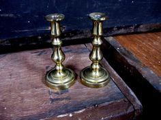 This is a gorgeous pair of small brass candlesticks. They are very solidly made and have a lovely, interesting patina. The candlesticks are in very good condition.  Each candlestick measures approx. 4 tall (10 cm).  *Please Note*  **** If you buy more than one item from my shop - then at the checkout a discount will automatically be applied to the shipping cost ***  To see all of the items in my store please click here www.etsy.com/uk/shop/MissieMooVintageRoom