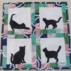 quiltkittyloveslife's photo: The final result of my cat mini. I love those black cat appliques