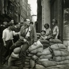 French Resistance fighters man a barricade in Paris (August, 1944)