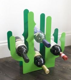 Make a statement with the Cactus Wine Rack. This high-quality durable wine rack is constructed of powder coated steel and available in a two-tone green finish. The cactus thorns hold up to eight bottles and provide a unique way to store your wine. Colorful Kitchen Decor, Kitchen Decor Themes, Home Decor, Stackable Wine Racks, Mason Jars, Gadgets, Deco Originale, Cactus Decor, Small House Plans