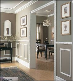 Crown molding, wainscoting, and panel inserts instantly add a touch of old world refinement to even the most mundane of rooms. gray and white