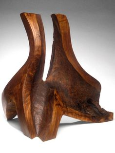 """Windshake walnut wood sculpture, standing horizontal or vertical, provided risky trajectory challenges to """"meet in the middle."""" Preview the results online."""