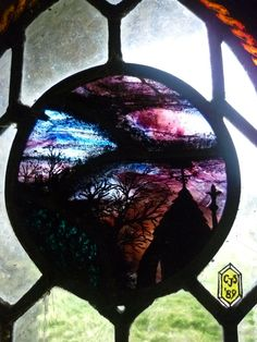 Abandoned Hobbit House, close up of stained glass windows
