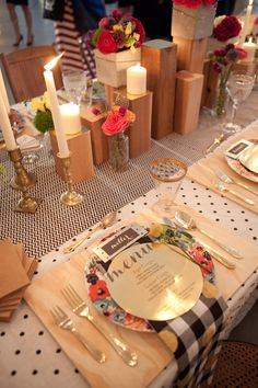 mixing pattern tabletop with polka dots, floral patterns, plaid. topped with a circular menu.