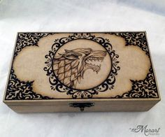 House Stark - Game of Thrones Pyrography by dcmorais on DeviantArt Wood Burning Crafts, Wood Burning Patterns, Wood Burning Art, Wood Crafts, Painted Wooden Boxes, Wood Boxes, Game Of Thrones, Woodworking Joints, Woodworking Crafts