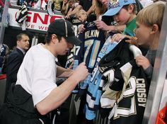 Sidney Crosby autographs fans' jerseys during fan appreciation ceremonies 4/7/12 after the Pens Flyers game.