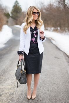 So right for work. Leather skirt, floral blouse, fitted contrasting blazer, neutral pumps.