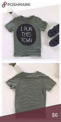 Boy t-shirt Olive colored t-shirt. Length 18 in, width 12 in flat ! Tag in the back is cut out because it bothered him 😳😊! Otherwise no flaws. Shirts & Tops Tees - Short Sleeve