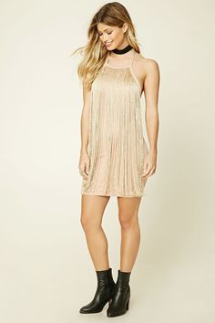 A stretch-knit mini dress featuring metallic fringe on front, a halter neck, and a concealed back zipper.