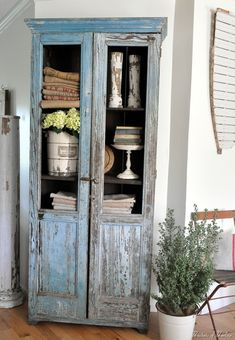 a gorgeous cupboard in a chippy robin's egg blue from Buckets of Burlap - love the finish AND staging... swoon!